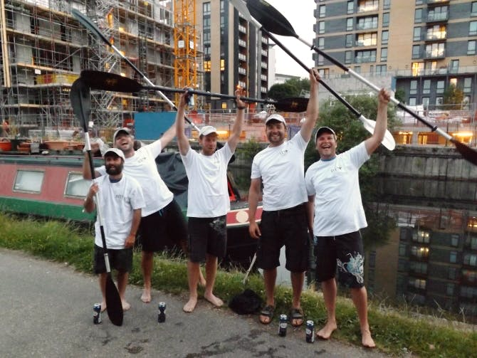 Peter Johnson (second from right) and his kayak team celebrate after finishing their epic journey!