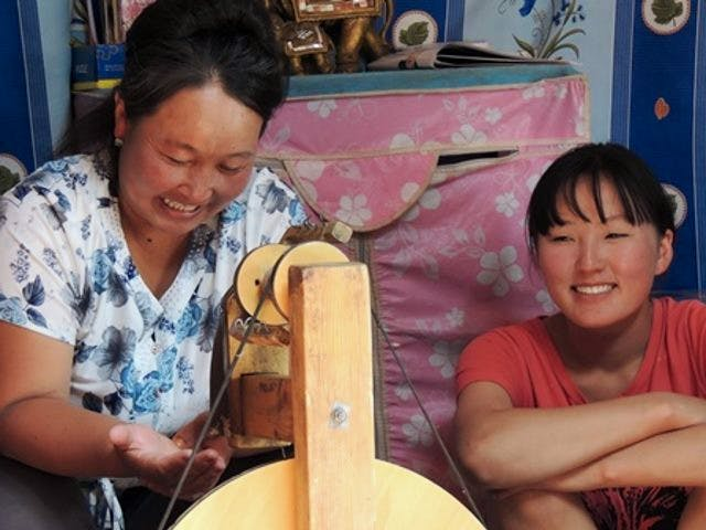 Community members in Tost spinning wool for Snow Leopard Enterprises products